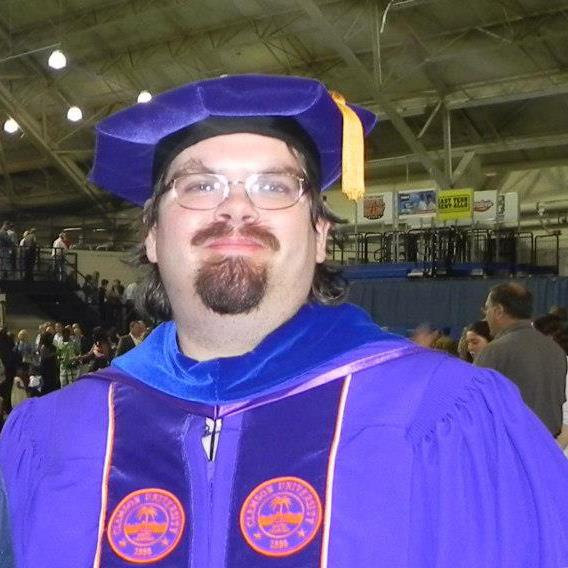 me at May 2013 graduation in full regalia